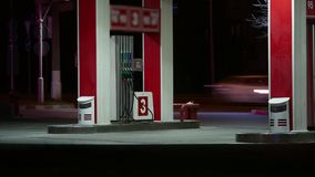 Cars are refueling gasoline at a gas station at night time-lapse. Gas station at sunset. Petrol gas station station at. Cars are refueling gasoline at gas stock video footage