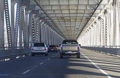Cars at Richmond–San Rafael Bridge, California. Richmond–San Rafael Bridge (also officially named the John F. McCarthy Memorial Bridge) with moving cars Royalty Free Stock Image