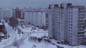 Cars ride by road near urban yard in winter, Novosibirsk. Cars ride by road near urban yard in winter. Full HD Resolution 1920×1080 Video Frame Rate 29.97 stock video
