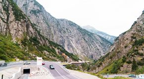 Cars riding on mountain serpentine in Alps, Switzerland. Cars riding on mountain serpentine in Alps Stock Photos