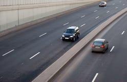 Cars on road. Blurreв road Stock Image