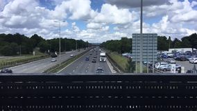 Cars on the road. Blue sky, clouds and cars on the road. England. Timelapse stock video footage