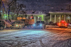 Cars on the road at night in the snow Stock Image