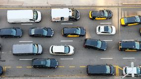 Cars on the road seen from above. They have only four colours: grey, white, black and yellow with black (taxis). Picture taken in Barcelona, Spain Royalty Free Stock Photography
