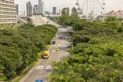 Singapore - December 2018: Cars on a road in Singapore. Singapore Flyer in the background stock photography
