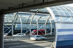 Cars on the road in the sound-absorbing tunnel. Metal structure and glass. Modern technology in the city of Warsaw, Poland stock image