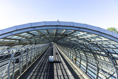 Cars on the road in the sound-absorbing tunnel. Metal structure and glass. Modern technology in the city of Warsaw, Poland Royalty Free Stock Photo