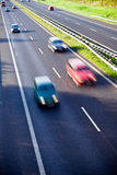 Cars on the road, traffic motion blur Stock Images