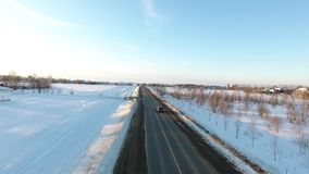 Cars on a road at winter season.. Cars on a road at winter season stock video footage