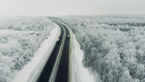 Cars on a road at winter season. 4K. Cars on a road at winter season stock video