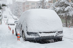 Cars and roads covered with snow Stock Photos