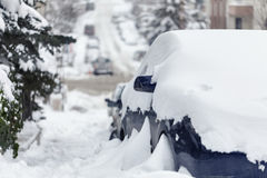 Cars and roads covered with snow Stock Images