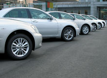 Cars row. In front of a cars shop Stock Images