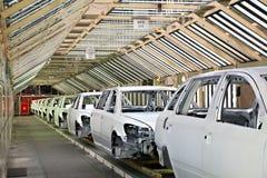 Cars in a row at car plant Stock Photos