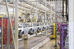 Cars in a row at car plant Stock Image