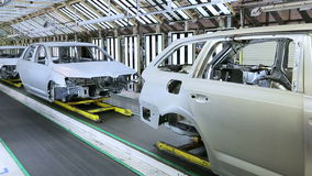 Cars in a row at car plant stock footage