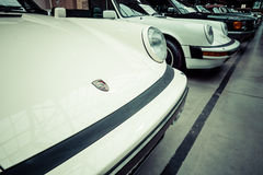 Cars in a row. In the foreground a Porsche 911 Royalty Free Stock Images
