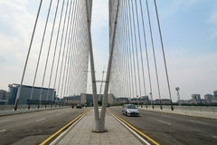 Cars run on modern bridge in Putrajaya, Malaysia Stock Photo