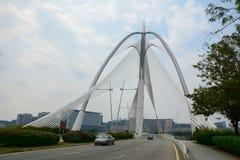 Cars run on modern bridge in Putrajaya, Malaysia Royalty Free Stock Photography