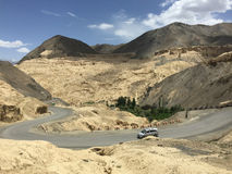 Cars run on the mountain road in Ladakh, India Royalty Free Stock Image