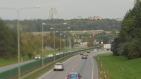 Cars running on highway down street. Four lanes two direction. Vilnius transport traffic. Blurry image stock video