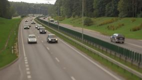 Cars running on highway down street. Four lanes two direction. Vilnius transport traffic. stock video footage