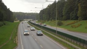 Cars running on highway down street. Four lanes two direction. Vilnius transport traffic. Blurry image stock footage