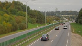 Cars running on highway down street. Four lanes two direction. Vilnius transport traffic. Blurry image stock video footage