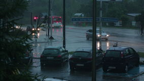 Cars Running with Lights On in the Rain stock video footage