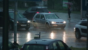 Cars Running with Lights On in the Rain stock footage