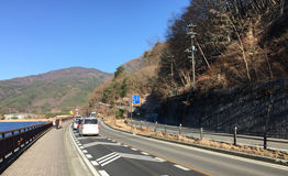 Cars running on the mountain road in Nikko, Japan Royalty Free Stock Images