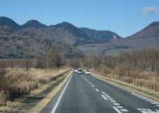 Cars running on mountain road in Yumoto, Japan Stock Image