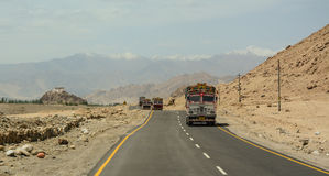 Cars running pass the road in Ladakh Royalty Free Stock Images