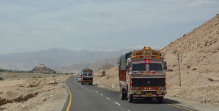 Cars running pass the road in Ladakh Royalty Free Stock Photo