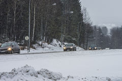 Cars running in the snowy weather Royalty Free Stock Photography
