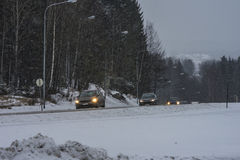 Cars running in the snowy weather Stock Images