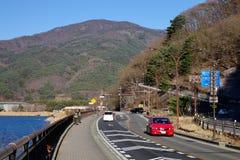 Cars running on street in Kawaguchi village, Japan.  stock photo
