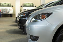 Cars for sale. Row of cars for sale in motor dealership Royalty Free Stock Images