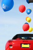 Cars sale. Red car and baloons Stock Photos