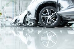Cars For Sale, Automotive Industry, Cars Dealership Parking Lot. Rows of Brand New Vehicles Awaiting New Owners, on the epoxy. Floor in new car service royalty free stock photos