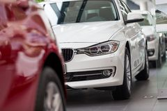 Cars for sale. BMW cars at car dealership showroom royalty free stock photography