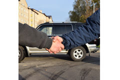 Cars for sale. Deal auto sales exchanged handshakes Royalty Free Stock Image