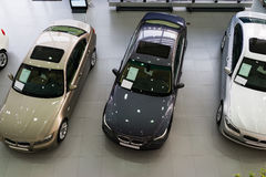 Cars for sale in showroom. Lined up cars in dealership showroom for sale Royalty Free Stock Images