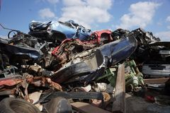 Cars for scrap. Stacked smashed cars for scrap, colorful, old and new Stock Photography