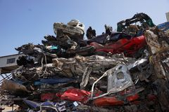 Cars for scrap. Stacked smashed cars for scrap, colorful, old and new Royalty Free Stock Image