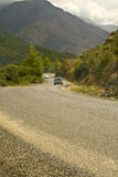 Cars on serpentine road in mountains Royalty Free Stock Images