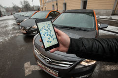 Cars-sharing - the opening of a new service car rental per minute. Saint-Petersburg, Russia - January 30, 2017: cars-sharing - the opening of a new service car royalty free stock photos