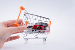 Cars in a shopping a cart Royalty Free Stock Image