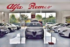 Cars in showroom of dealership Alfa Romeo stock image