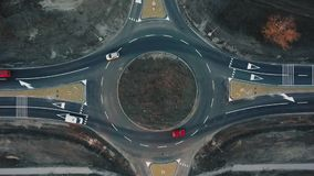 Cars are moving through a newly built traffic circle stock video footage